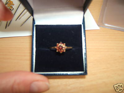 Gold ring with garnet stones